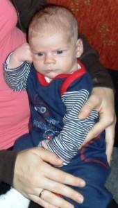 csecsemő arcjátéka